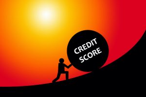 """Man rolling """"Credit score"""" up a hill"""